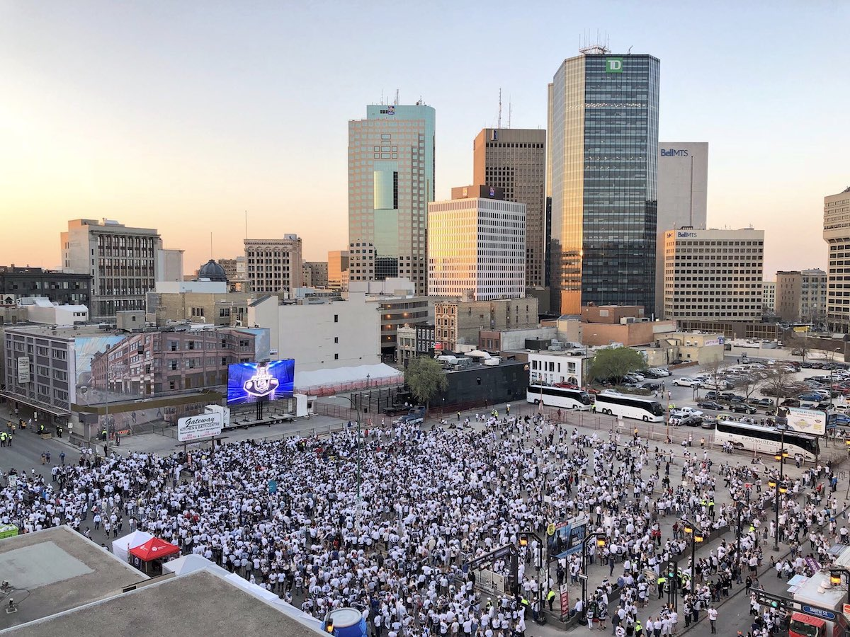 Taking the Winnipeg Whiteout to the streets, and to the world - Fans celebrate during a Winnipeg Whiteout Street Party in the 2018 playoffs (Jay Murray)
